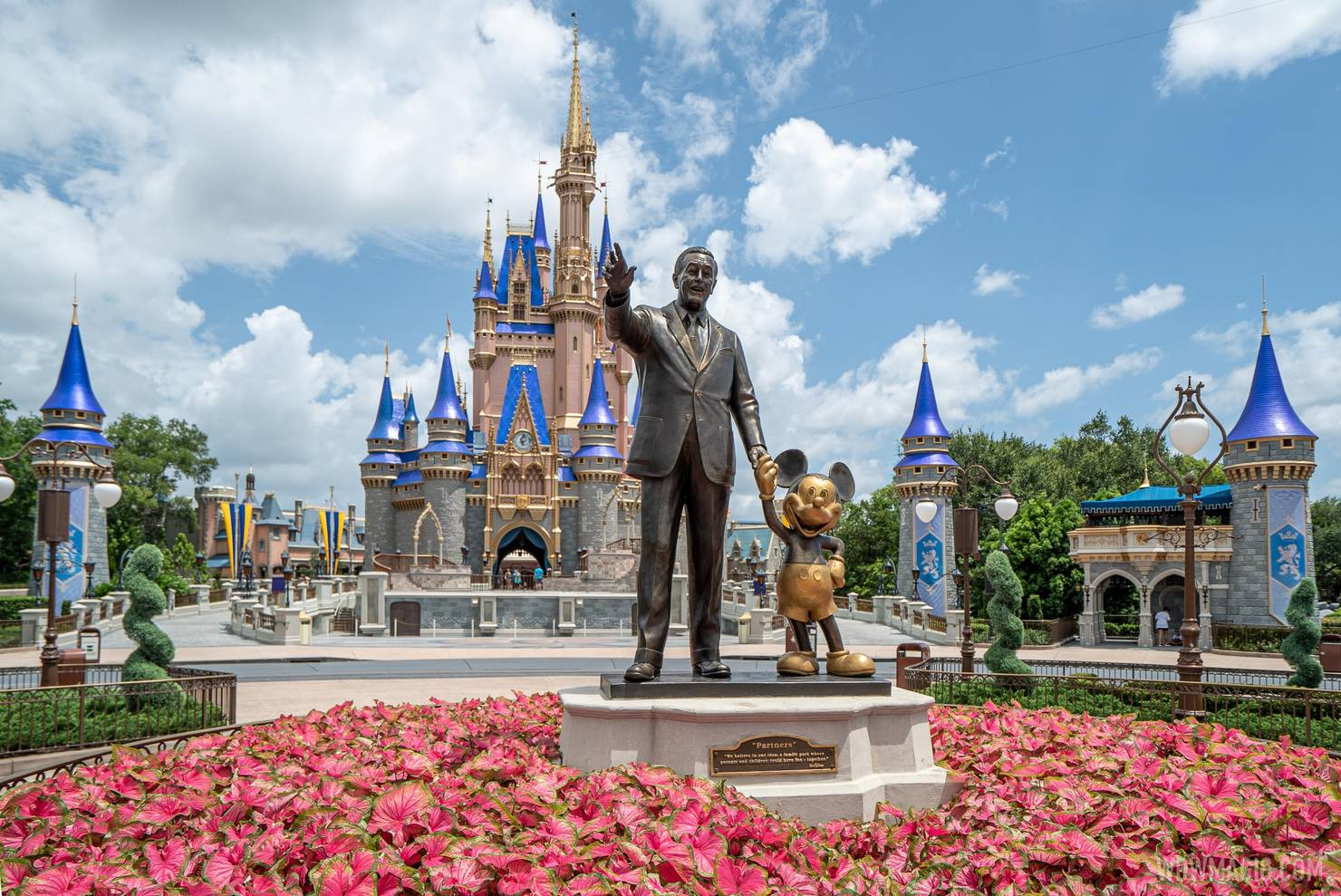 Walt and Mickey in the center of the Magic Kingdom hub