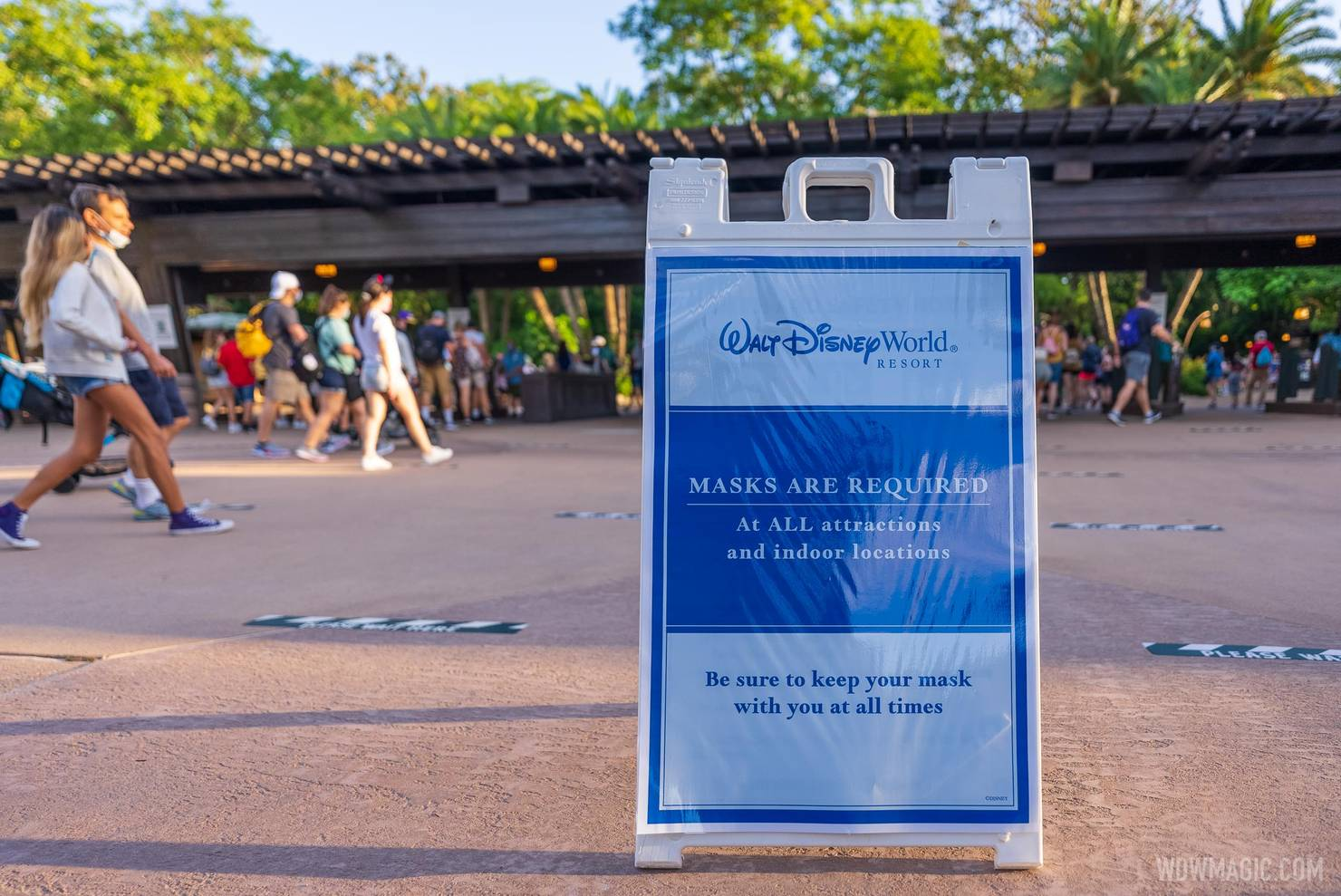 Signage from May 2021 when Disney relaxed outdoor masking but still required indoor masking