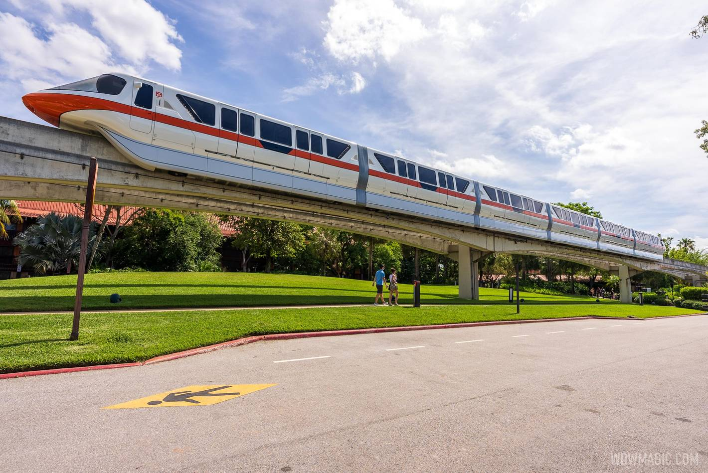 Monorail Orange on the Express Beam passes by Disney's Polynesian Village Resort